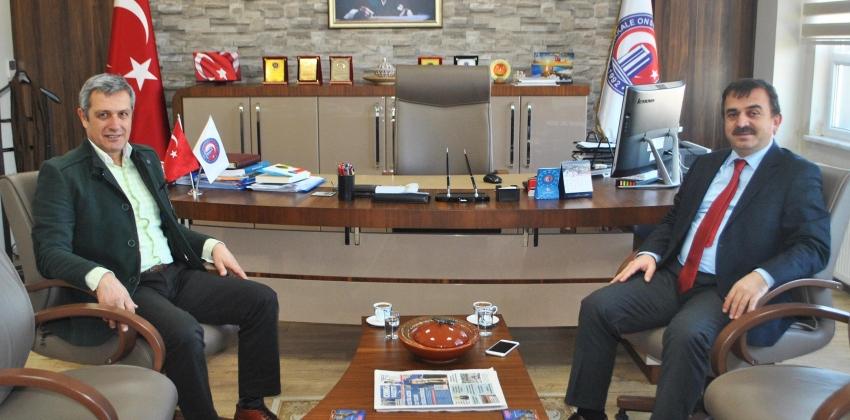 Çanakkale İl Milli Eğitim Müdürü Osman Özkan, Yüksekokul Müdürümüz Yrd. Doç. Dr. Enver Yolcu'yu ziyaret etti