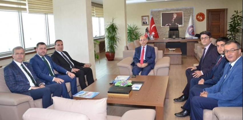 Ezine Protokolü Rektör Prof. Dr. Sedat Murat'ı Ziyaret Etti
