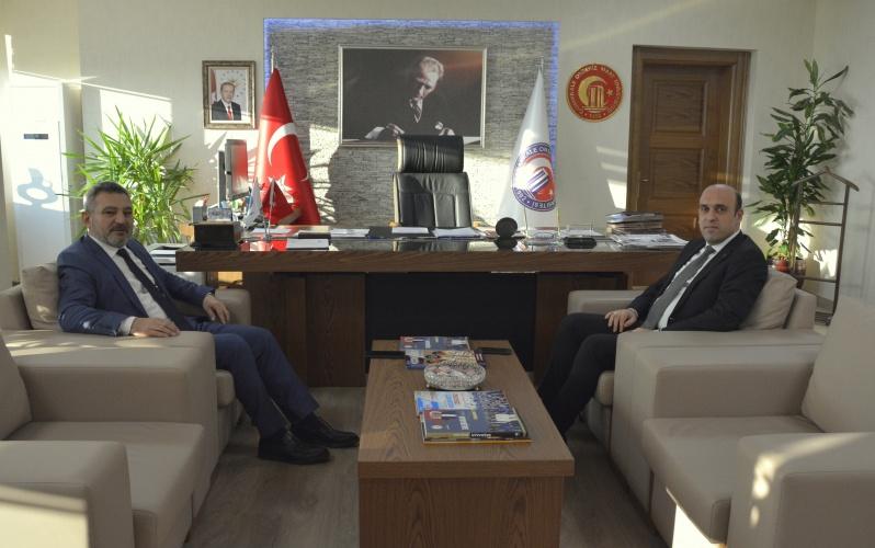 Biga Kaymakamı Mustafa Can, Rektör Prof. Dr. Yücel Acer'i Makamında Ziyaret Etti